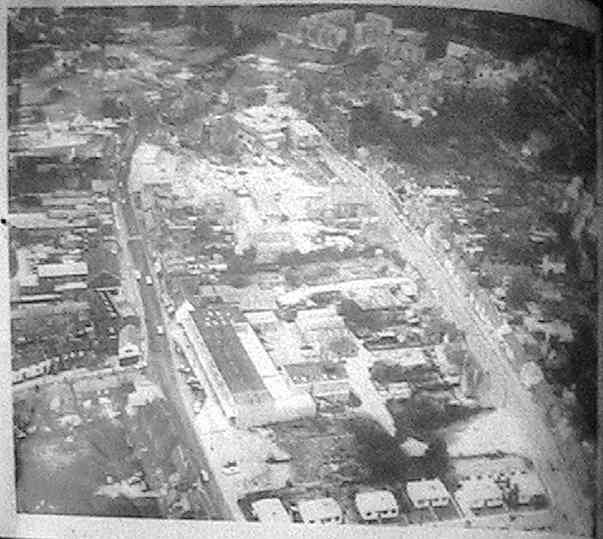 Aerial view of Wokingham Town Centre with Cross Street prefabs in foreground